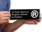 More No Weapons Signs