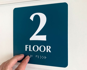 Braille 2nd floor sign