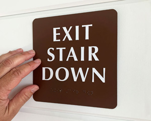 Braille exit down stair sign
