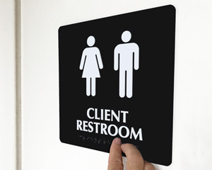 Customized restroom sign