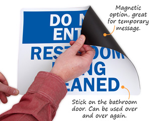 Magnetic restroom being cleaned sign