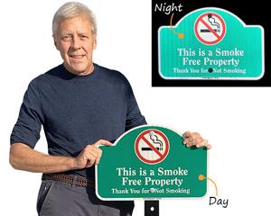 Reflective smoke free property sign