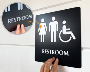 Restoom sign with braille