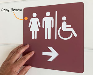 Restroom sign with arrow