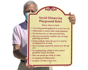 Social distancing rules sign for a playground
