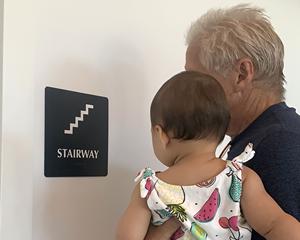 Stairway door braille sign