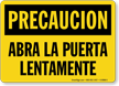 Precaucion Abra La Puerta Lentamente Spanish Sign