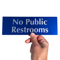 No public restrooms sign made from durable anodized aluminum