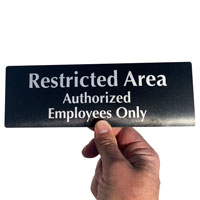 Restricted authorized employees only Sign made from durable anodized aluminum