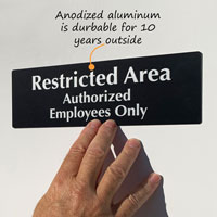 Restricted authorized employees only Sign