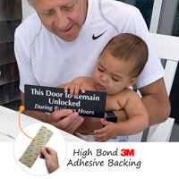 Keep door unlocked sign has an aggressive adhesive backing for easy application
