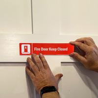 Fire Door Keep Closed Sign on a Door