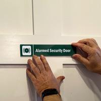 Alarmed Security Sign on a Door