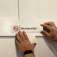 This Is Not An Exit Sign on a Door