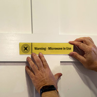 Warning: Microwave in Use Sign on a Door