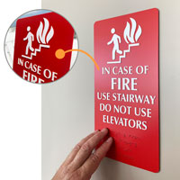 In case of fire use stair sign with braille and tactile lettering