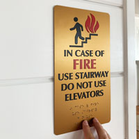 Gold fire exit sign