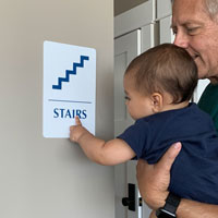 Stairs sign with braille