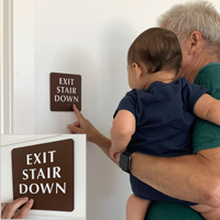 Braille exit stair down sign