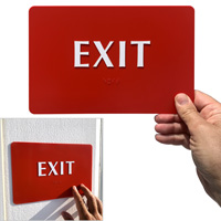 Braille exit sign in red