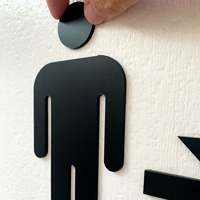Routed acrylic men's and women's room signs with arrows